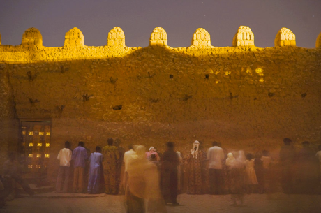 With foreheads pressed against the outer wall of the great mosque of Djingarey-Ber, celebrants of Mawlid pray for their hopes in the coming year. Islam In Tibuktu is highly influenced by Sufism.